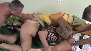 Busty German swingers having an orgy