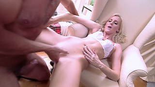Blonde slut in a uniform gets fucked and covered in cum