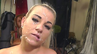 Blonde plays with her pussy to warm it up for hard doggy action